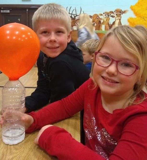 Barrie Club members learning an inventive way to inflate balloons. -