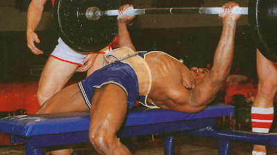 Powerlifitng bench press, notice the arch and lower body engagement