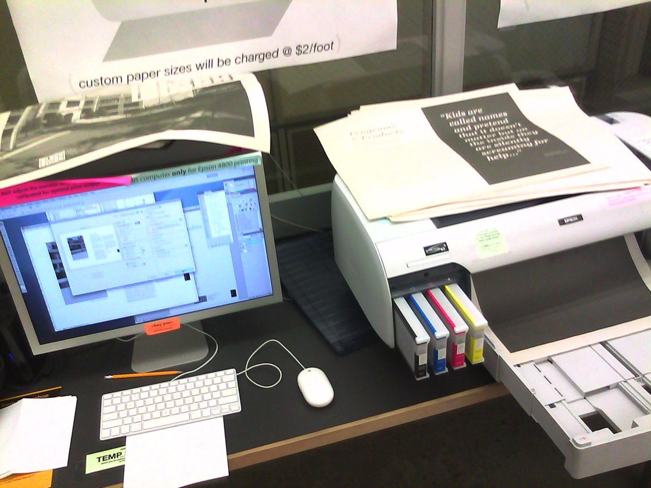 "printing the 48 page newspaper (hand fed through the epson) for the ""Block by Block Corporation"" :)"
