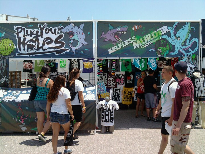 FIRST PICS FROM WARPED 2010! This is a design/illustration collaborative project I did with Sam Dean of  Plugyourholes.com  & Joe Murder of  Selfless Murder Clothing . We made Tents, Banners, Tees, Merch, Flyers, Drop Cards, the whole shi-bang. More pics to come :)   Go check it out at EVERY Warped location in the US! (and get some free stickers and water while you're there!)    ***10% OFF CODE @ PLUGYOURHOLES.COM***  =  RUMMELKILLS