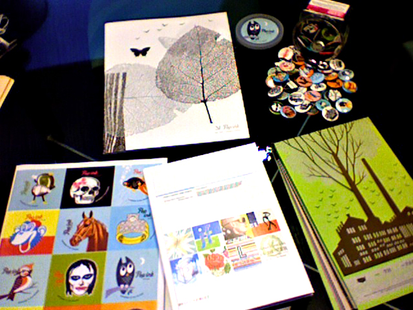 So I FINALLY found an internship for the summer! Today I started at Charles S. Anderson Design Studio in downtown Minneapolis and let me tell you, it is awesome! Check out all of their links:   CSA DESIGN   CSA IMAGES   POP INK   FRENCH PAPER    I also left with a bunch of FREE swag! Below are a bunch of buttons, a full CSA Portfolio Book,a freshly printed French Paper product guide, a POPink product guide, and a sheet of POPink stickers! (sorry for the bad quality photo)