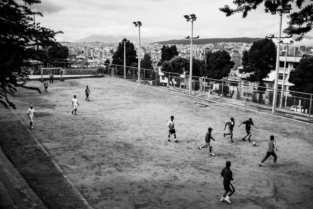 A pick-up soccer game on a field overlooking Quito, Ecuador. 05 June 2014, Photo by Bear Guerra