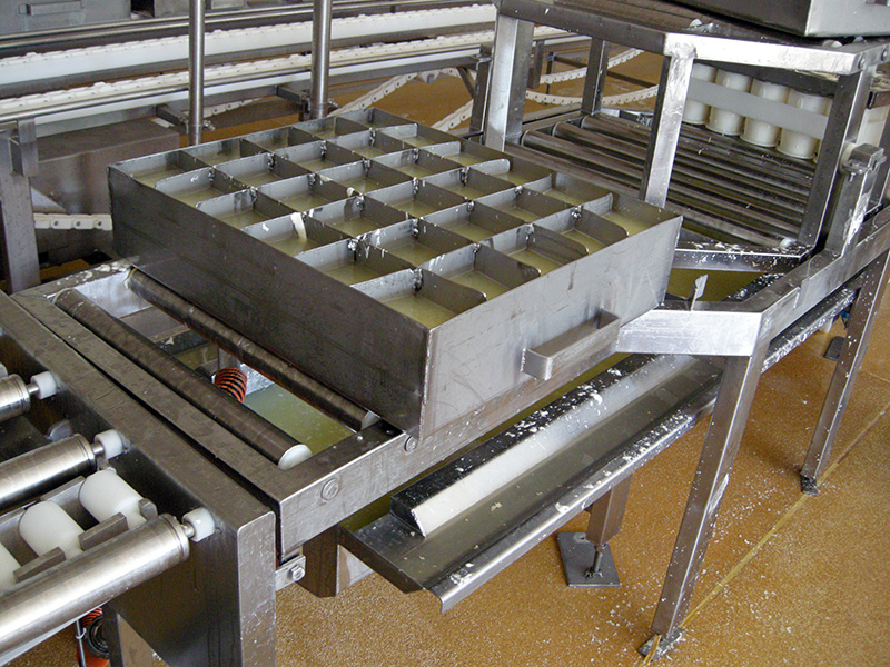 Curds being turned and cut into moulds