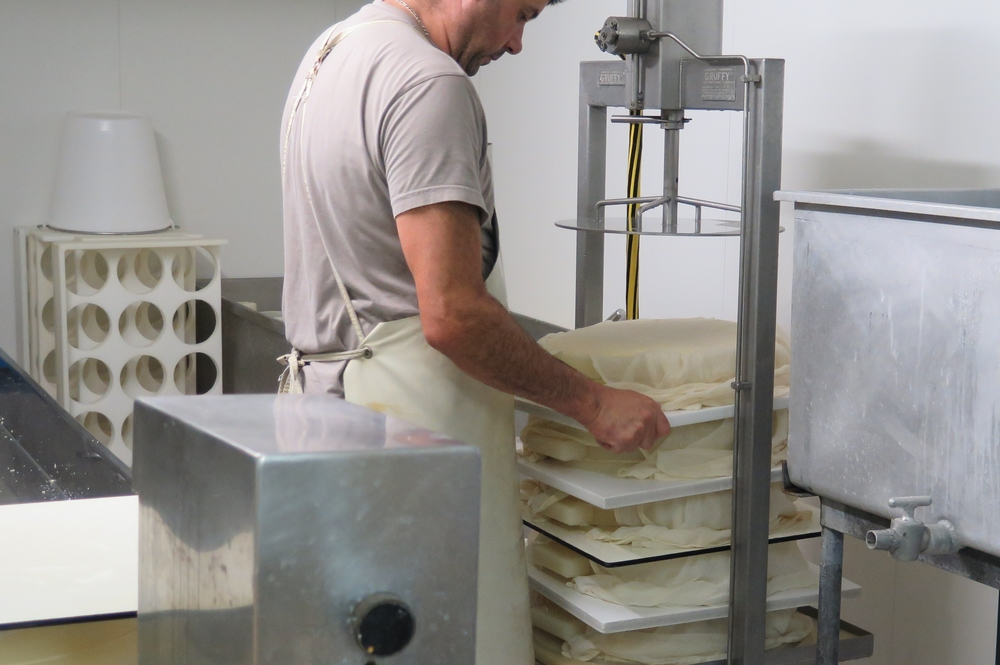 Pressing the cheeses