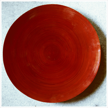 The red wooden tray.