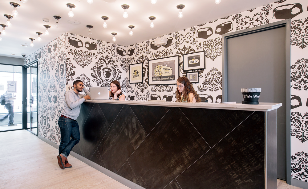 A Hostess cupcake inspired damask wallpaper installation in the lobby of WeWork Wonderbread Factory in Washington D.C.