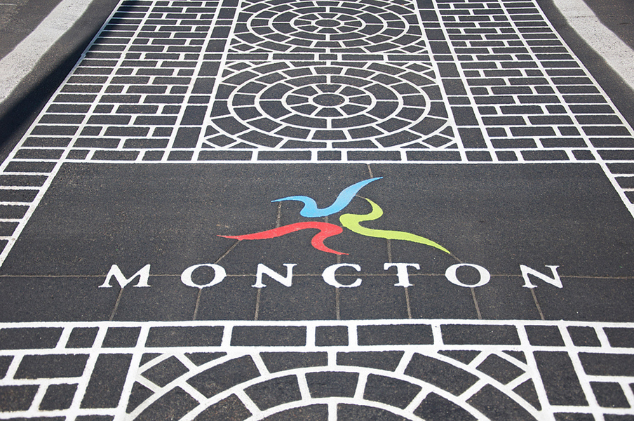 City of Moncton logo in context - branded crosswalk, downtown Moncton