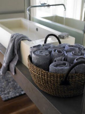 Roll up towels for pretty decor and a spa feel.