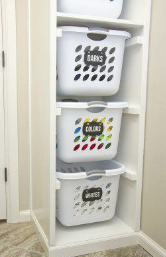 https://www.bloglovin.com/blogs/make-it-love-it-2254463/diy-laundry-basket-organizer-built-in-4720300607