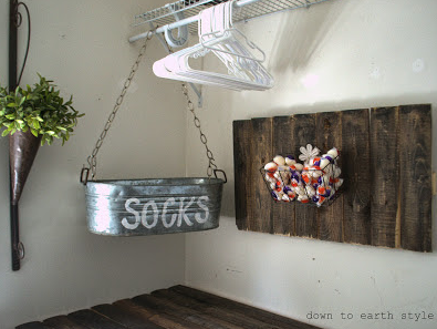 http://downtoearthstyle.blogspot.com/2013/09/old-fence-features-in-laundry-room.html
