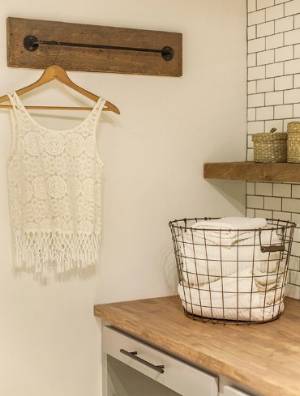 http://www.idecz.com/08/24/hnew-laundry-room-the-reveal-the-curtain-rod-is-a-great-alternative-for-hanging-items/
