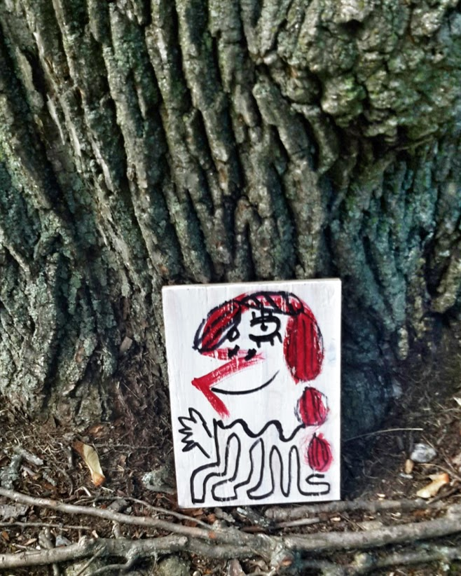 Portrait of a girl. Hidden up against tree. Carter Park, Leominster, MA.