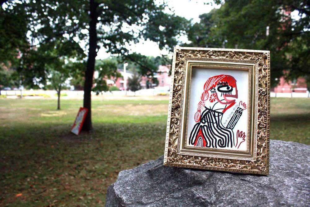 A piece of framed artwork posing in Carter Park, Leominster, MA