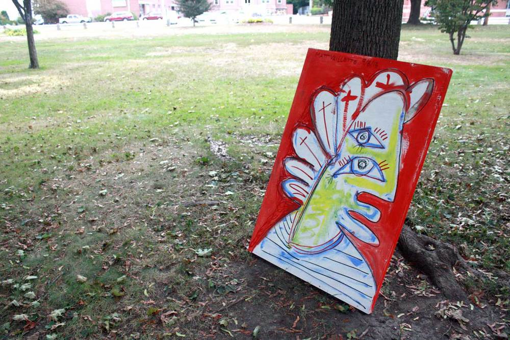 Photo of a large mixed media painting on public display in Carter Park.