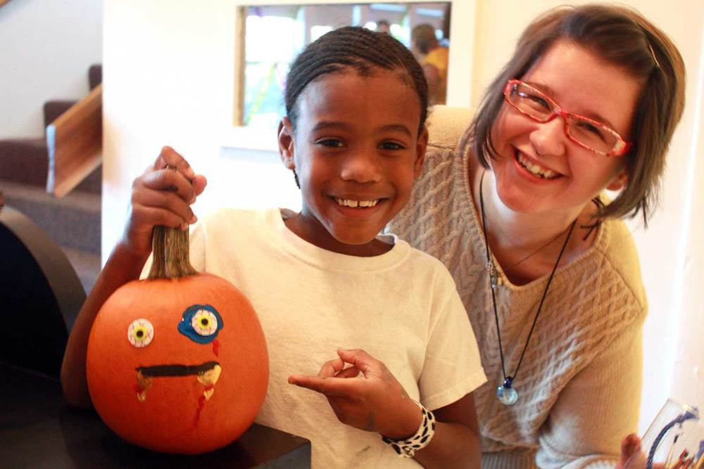Amy & Rolffy with his spooky painted pumpkin—from our 10/27/2014 pumpkin painting class.