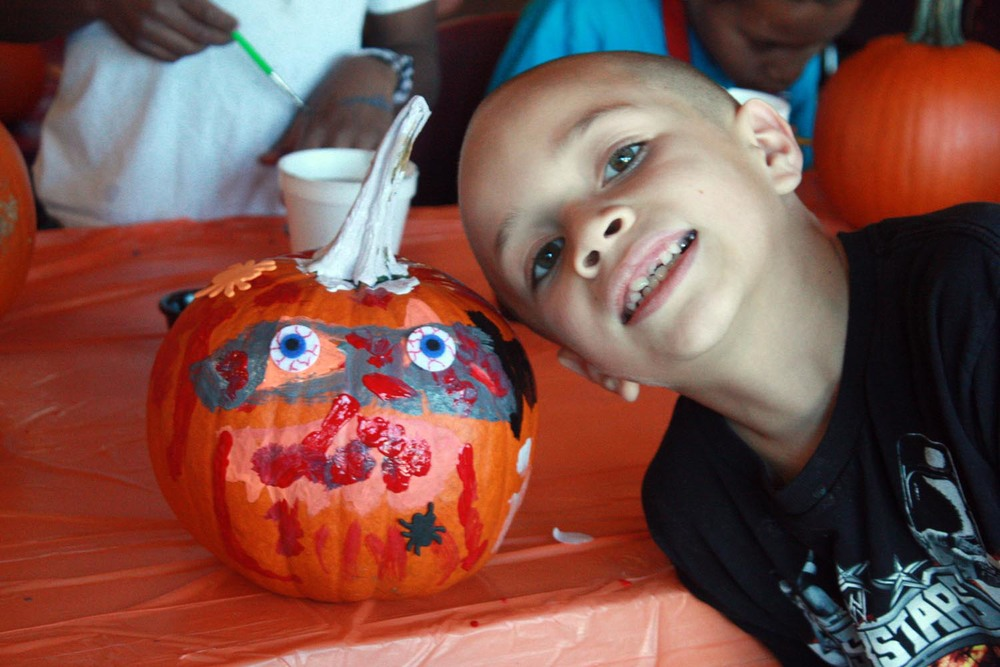 A young artist with his scary pumpkin!