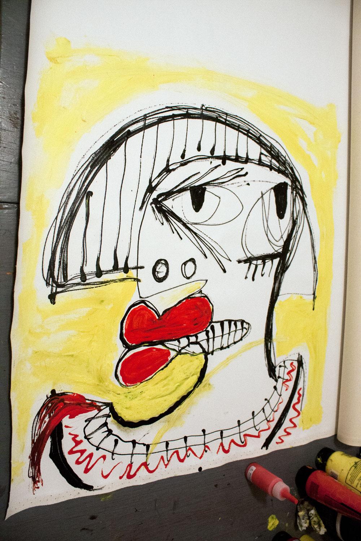 The portrait on an uncut canvas roll.
