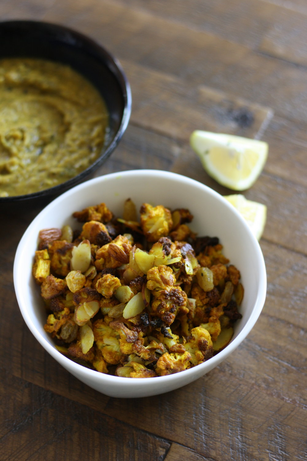 Photo (clockwise): Shorbat Addas,  Turmeric Roasted Cauliflower with Shaved Almonds and Golden Raisins.