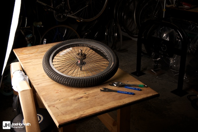 Bicycle wheel and tools lit by a softbox