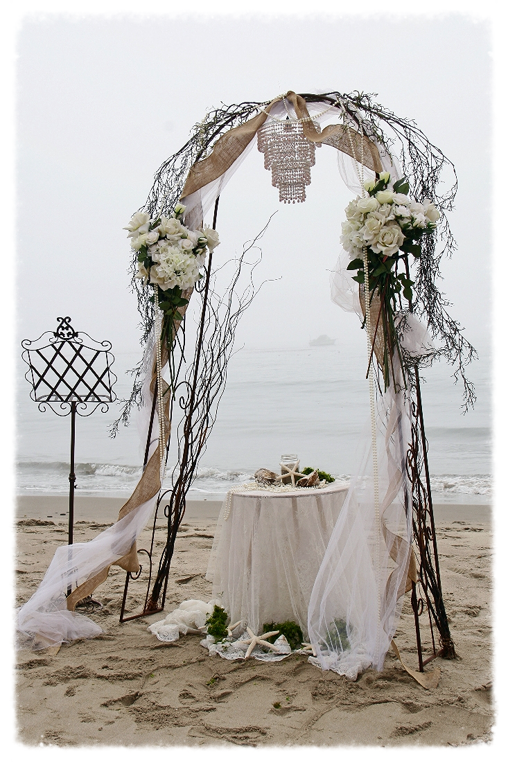 Romantic Wedding Arch -  Includes two silk flower arrangements, white tulle, chandelier, burlap ribbon, green moss, ceremonial table , strands of pearls,