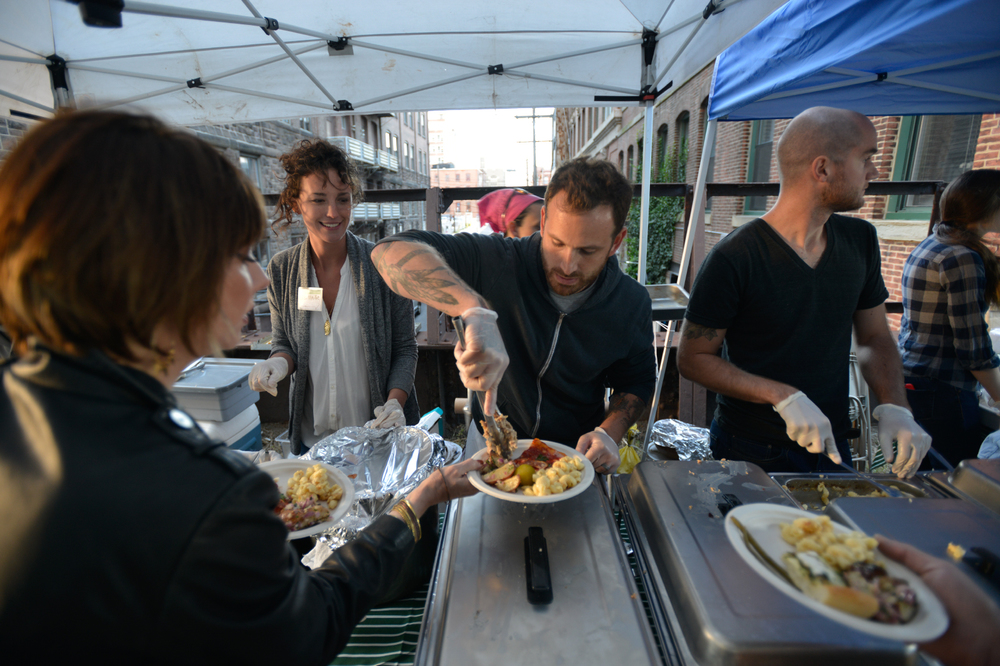 """Michael Pasquarello [center] and 13th Street Kitchens gang [Café Lift, Prohibition Taproom, and Bufad] roasted two pigs and packed our plates with pickles, pizza, potatoes, and possibly other foods that don't start with """"p."""""""
