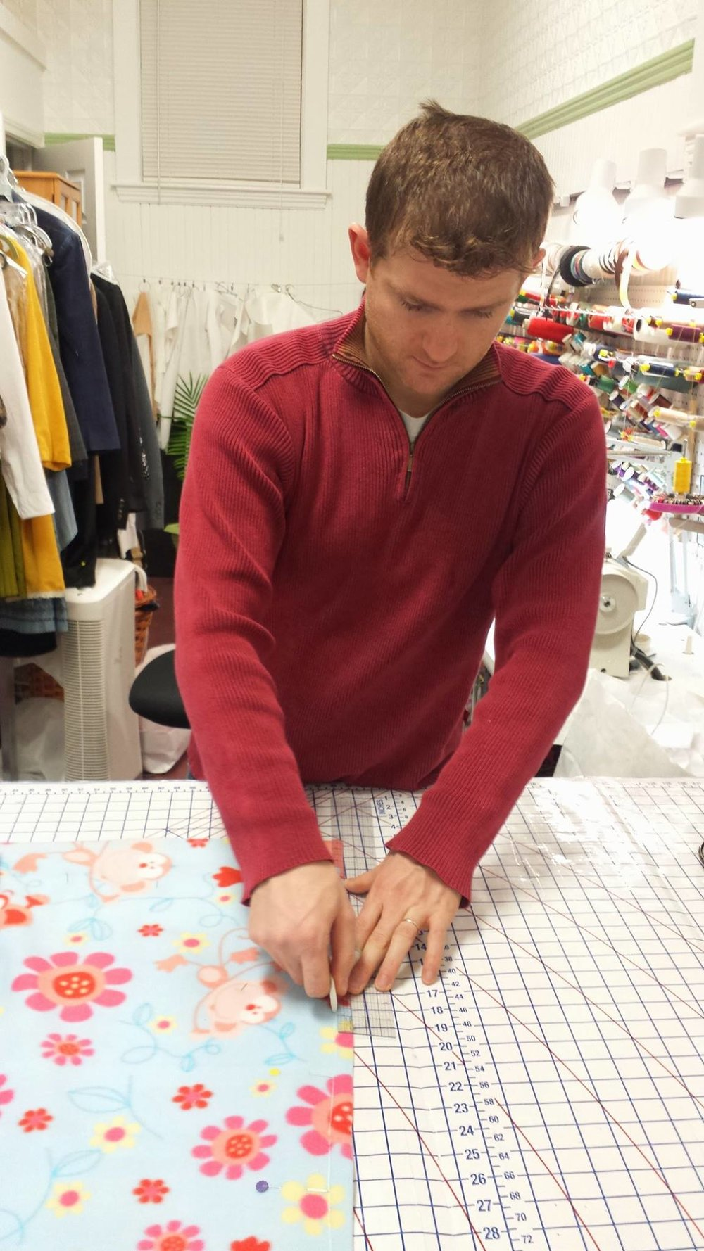 Konstantin is learning to make a baby blanket for his daughter