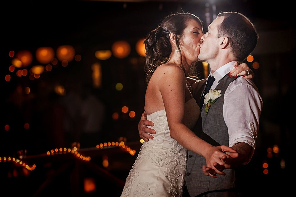 Wedding couple kiss on their first dance at reception in Playa Fiesta Mexico