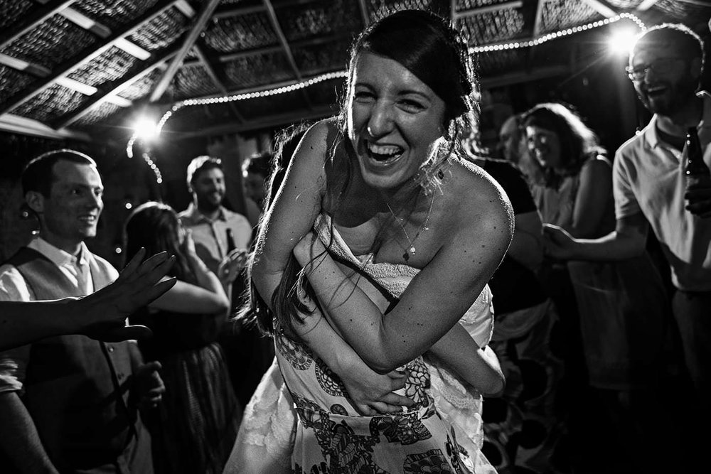 A girl friend of the bride pick her up in the middle of the dance floor at reception held in Playa Fiesta Mexico