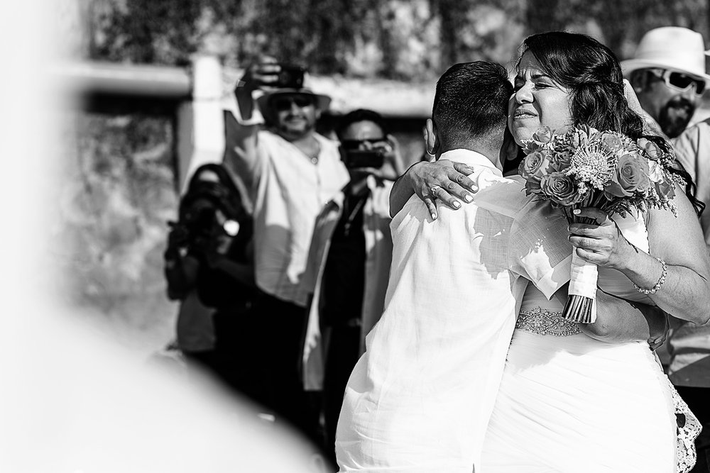 Bride hug her son at the end of the aisle for wedding ceremony to start