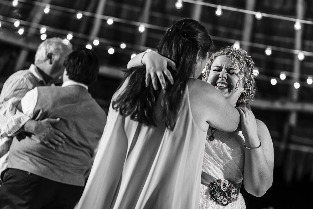 Bride dancing with mother-in-law at wedding reception