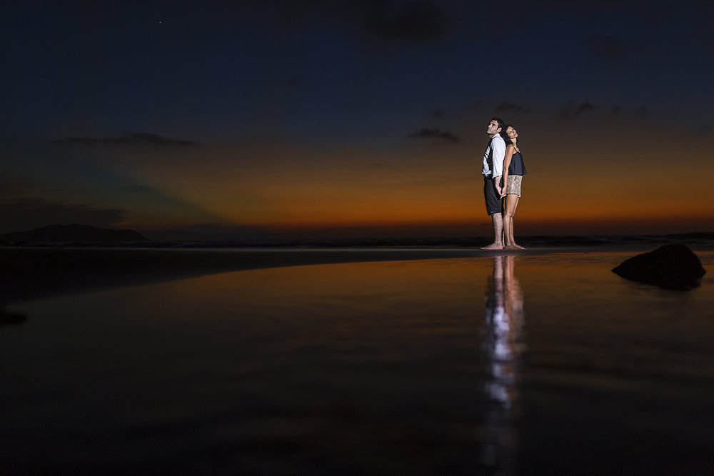 Punta de Mita sunset with couple standing back to back on the beach - Imanta Resort