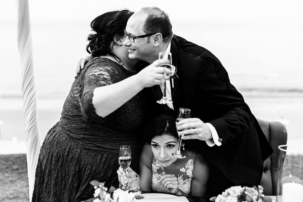 Maid of honor and groom hug after speech and squish bride between them - Fearless award