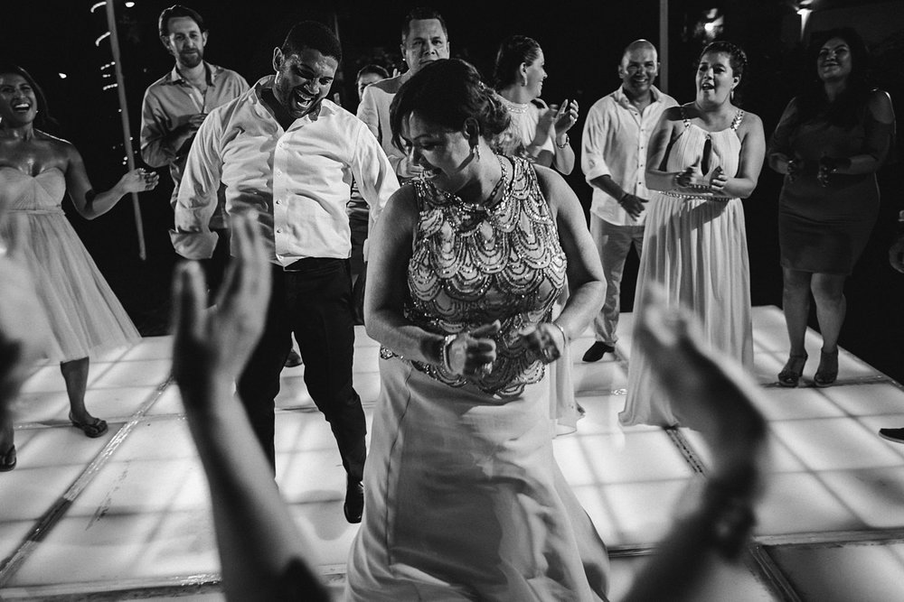 Mother of the bride and guest dancing inside the circle