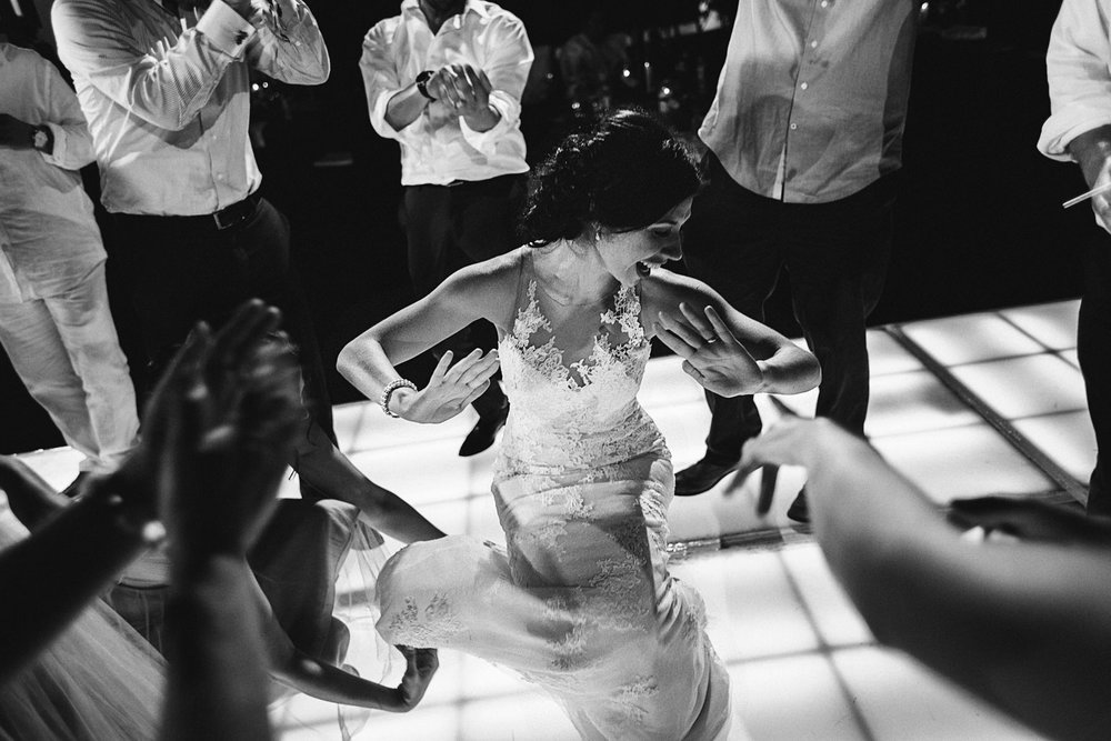 Bride showing off her best moves on the dance floor at her wedding reception party