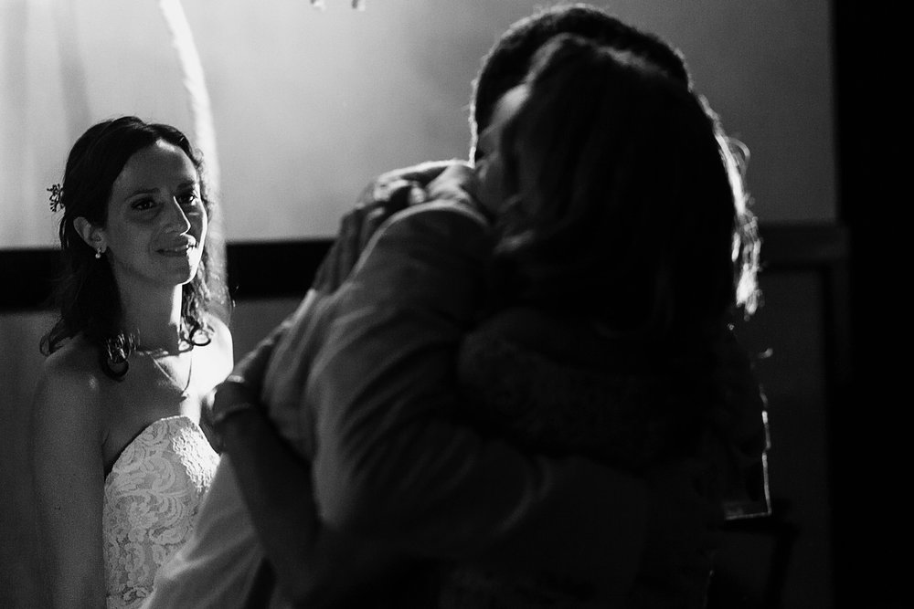 Bride watch groom and mother-in-law hugging during wedding reception - Eder Acevedo cancun los cabos vallarta wedding photographer