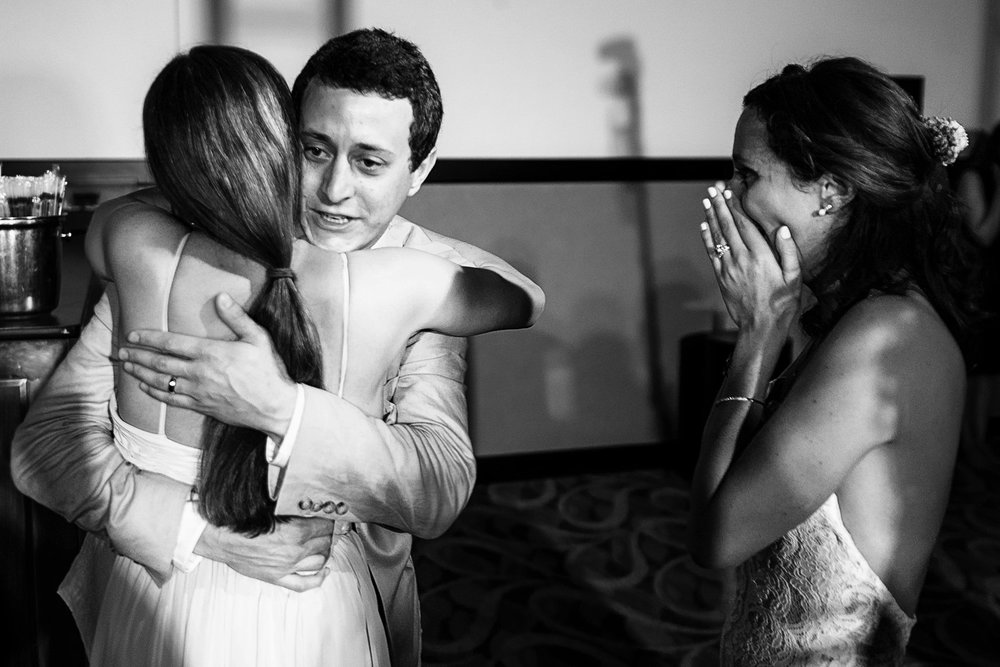 "Groom hugs bridemaid for singing ""At Last"" on stage during wedding reception - Eder Acevedo cancun los cabos vallarta wedding photographer"