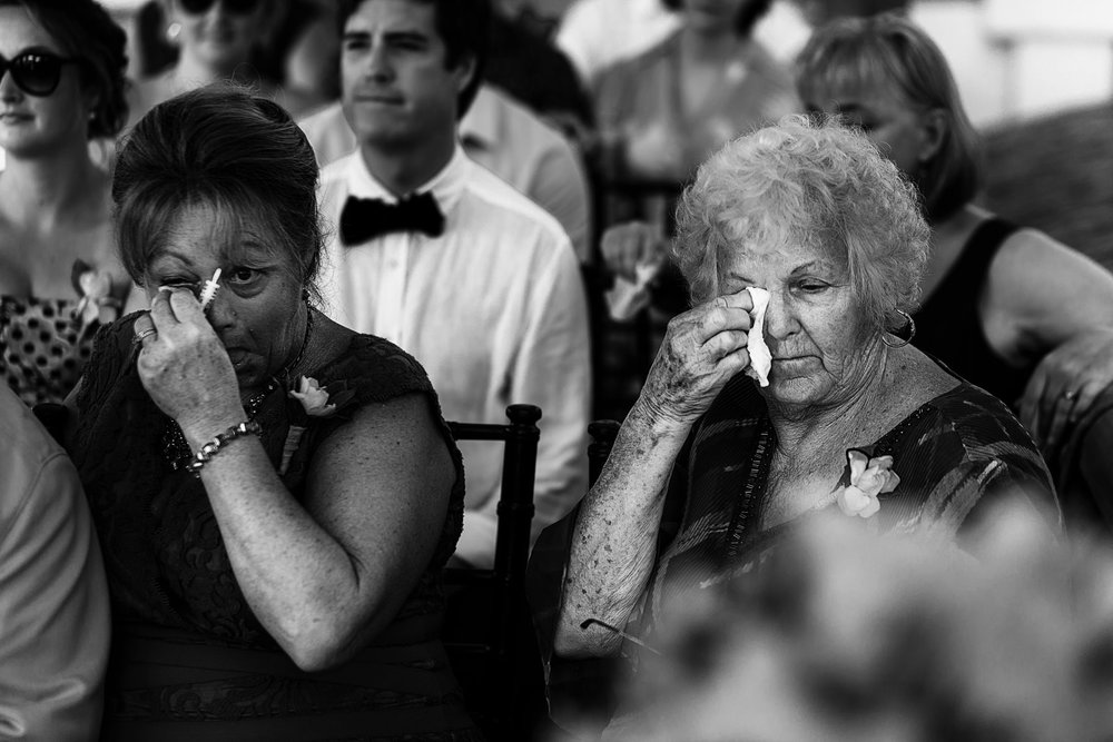 Mother and grandmother of the bride crying during the wedding ceremony
