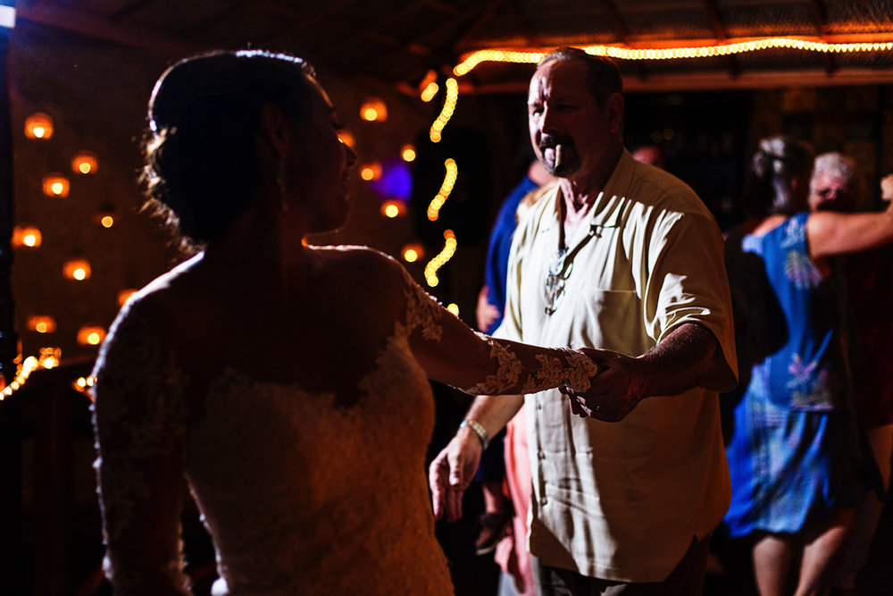 Bride and her dad dancing and shaking their booties during the wedding reception