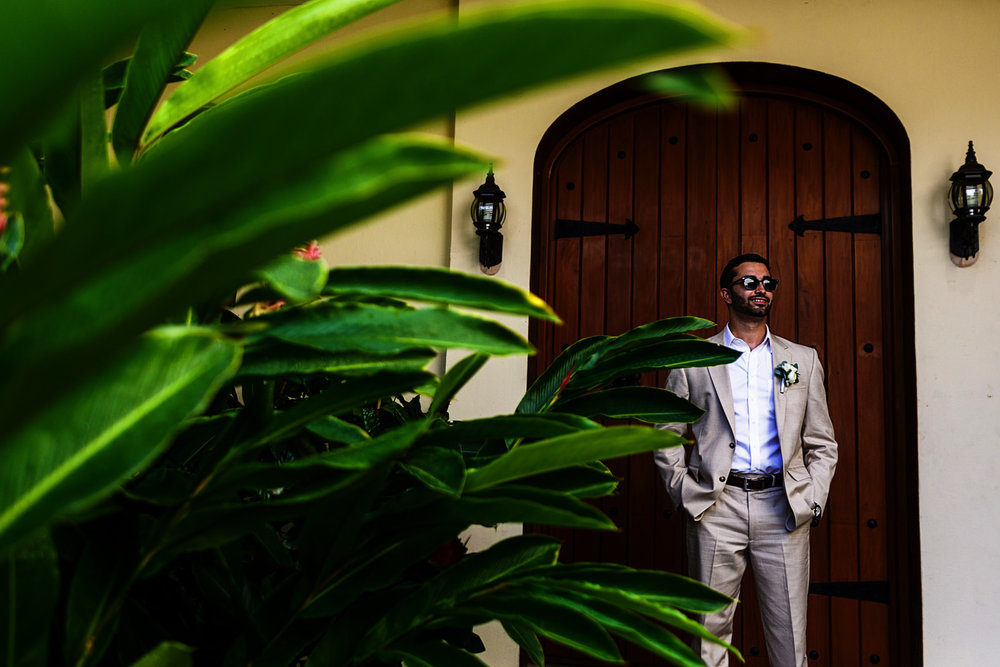 Portrait of the groom outside a villa in Mismaloya Mexico