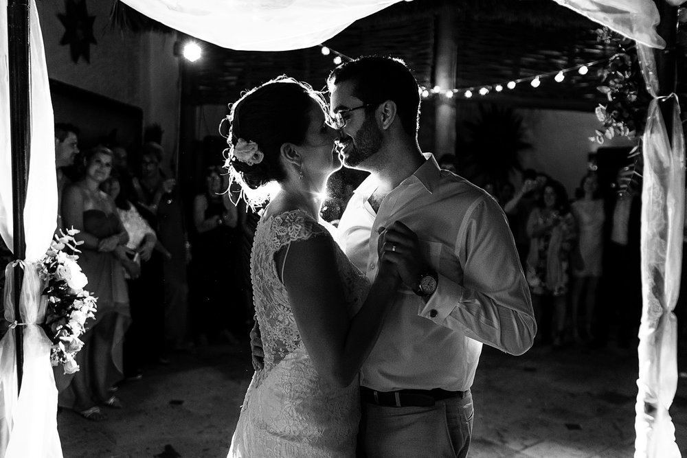 Couple about to kiss during their first dance