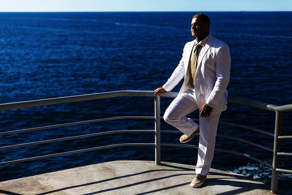 Portrait of the groom with the pacific ocean on the background