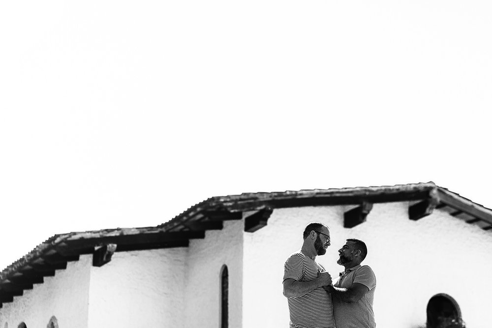 Couple facing each other framed on a wall in black and white, destination wedding photography