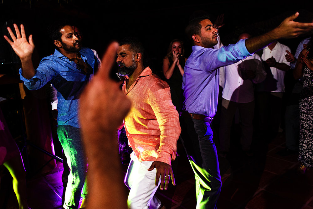 Groom and hindi guests dance their music style