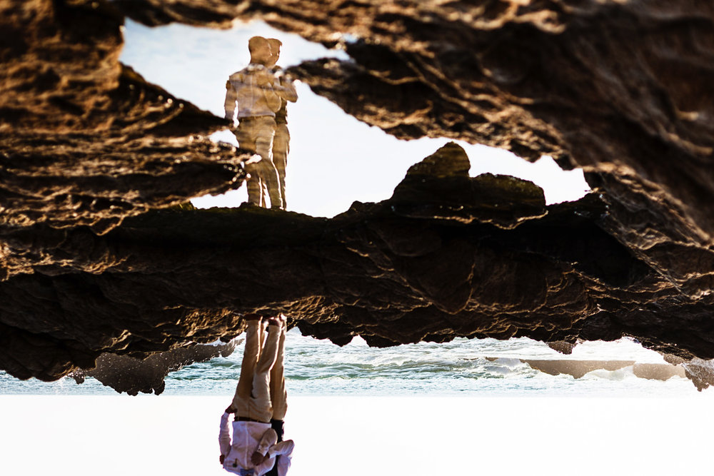 Gay couple portrait on their destination wedding in Mexico, upside down and reflected in the water