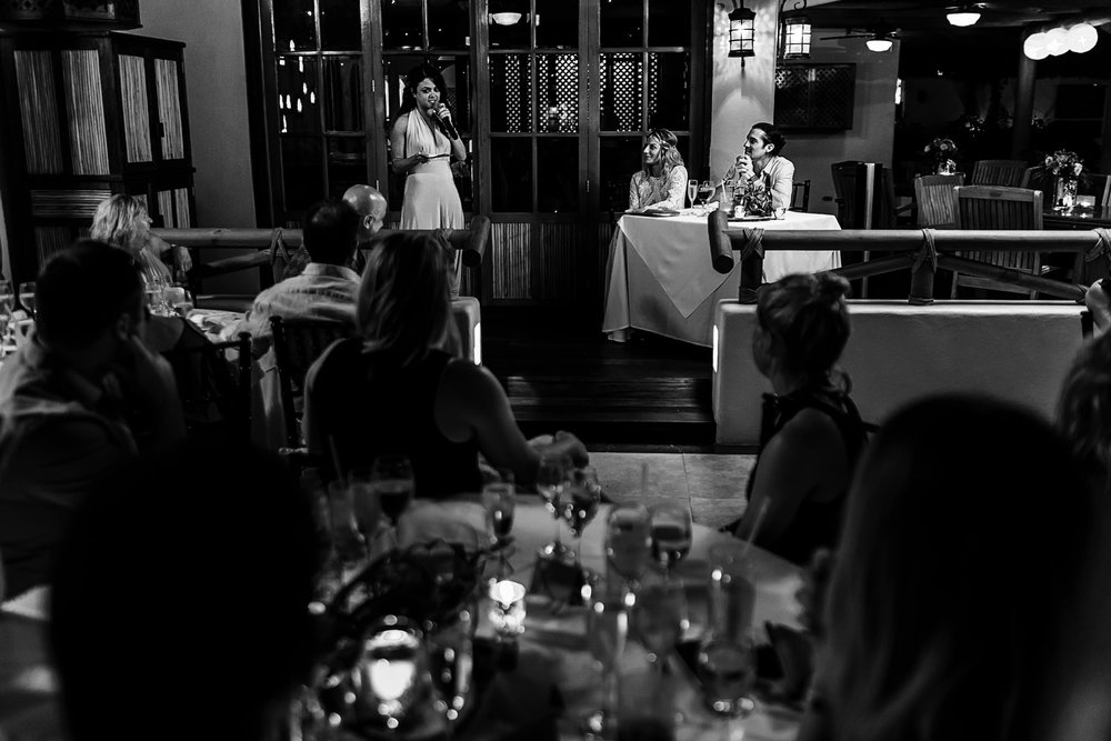 Maid of honor giving a speech to the groom and bride on their wedding reception