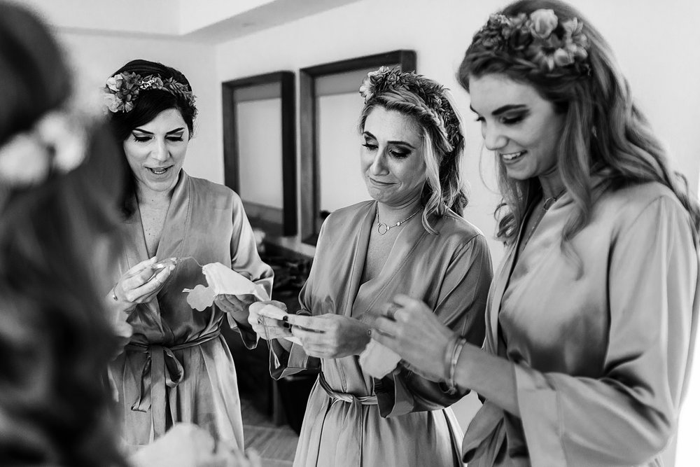 Bridesmaids receiving a little gift from the bride