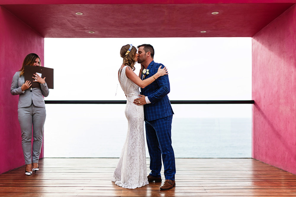 First kiss bride and groom at the Presidential Suite on Hyatt Ziva Puerto Vallarta resort