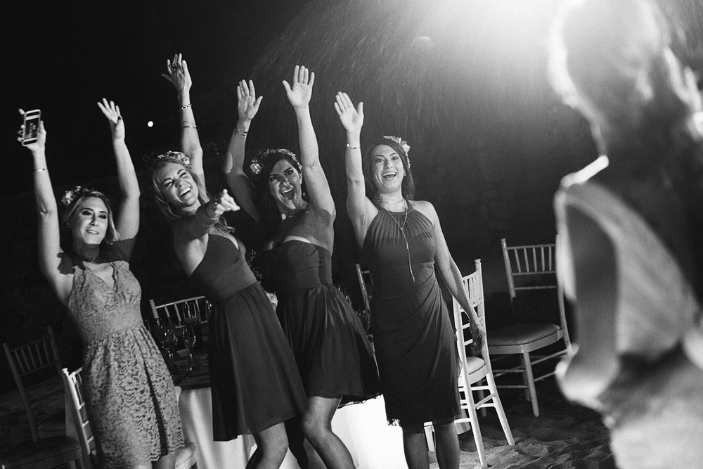 Bridesmaids cheer for the couple duirng their first dance