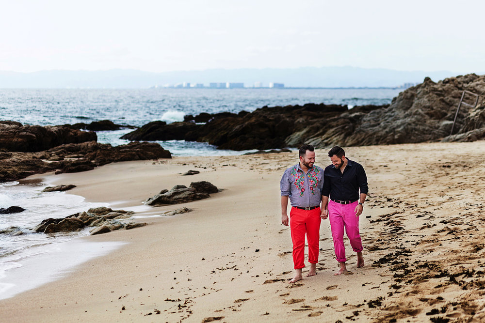 gay-couple-walking-sand-conchaschinas
