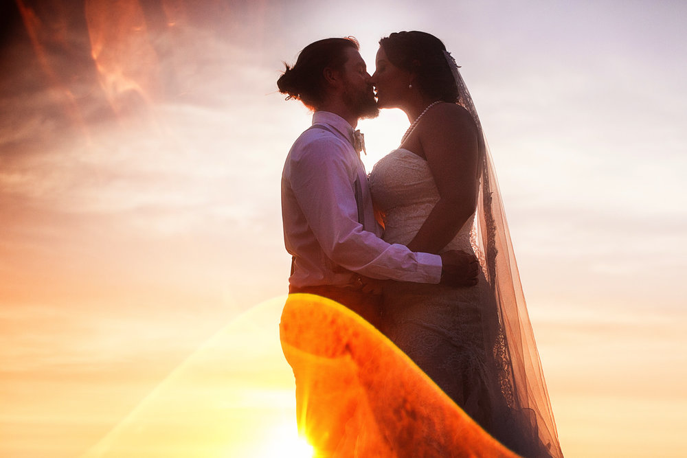 Wedding couple about to kiss against the sunset in Puerto Vallarta, Mexico